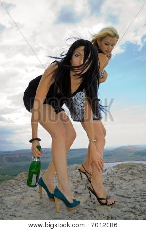 Two Girls With A Champagne Bottle
