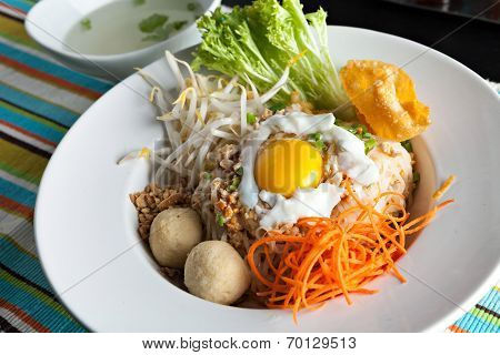 Gai pad bai gaprow style Thai dish with fried egg and rice noodles. poster