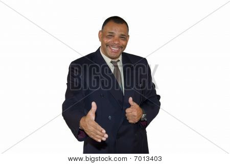 smiling businessman reaching out his hand and posing thumbs up
