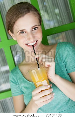 Beautiful Woman Drinking Juice