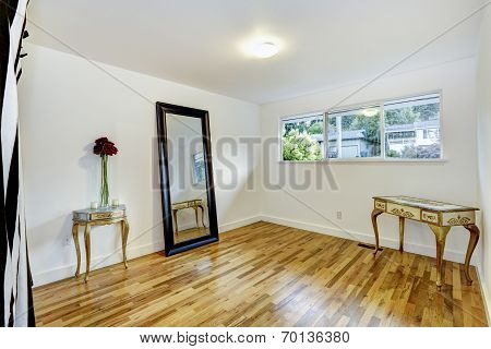 White Empty Room With Antique Tables And Mirror
