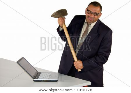 businessman hitting laptop with sledgehammer