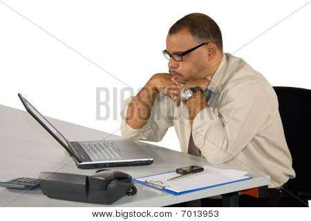 concentrated working mature African-American businessman
