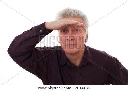 Elderly Man Holds Glasses On A White
