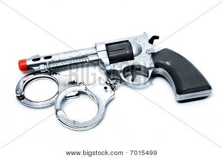 Toy Gun And Handcuffs