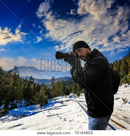 Photographer On Snowy Road To Coniferous Forest