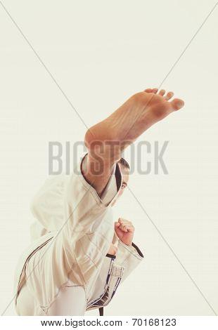 Man In Kimono Beat A High Leg Kick