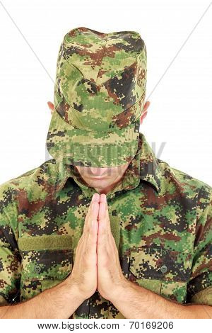 War Soldier Praying In Military Camouflage Uniform With Head Bowed
