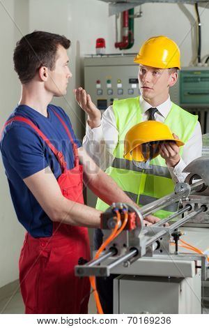 Inspector Controlling Safety During Work At Factory