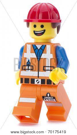 Ankara, Turkey - March 15, 2014 :  Lego movie minifigure character Emmet walking isolated on white background.