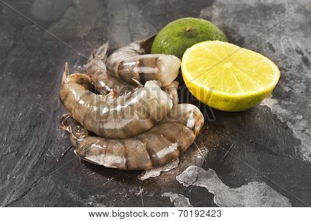 Fresh tiger shrimp arranged against against grey slate