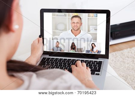 Young Woman Using Laptop For Videochatting