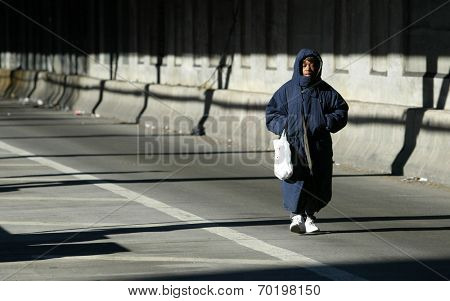 NEW YORK - DECEMBER 21:  A pedestrian walks over the Queensborough Bridge (59th Street Bridge) during the second day of the transit strike December 21, 2005 in New York City.