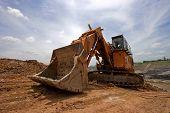 track type loader excavator machine doing earthmoving poster