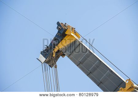 Large Crane Jib Against Blue Sky Background