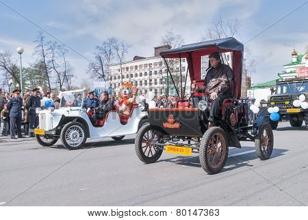 Tyumen, Russia - May 9. 2008: Parade of Victory Day in Tyumen. Old-fashioned cars participate in parade poster