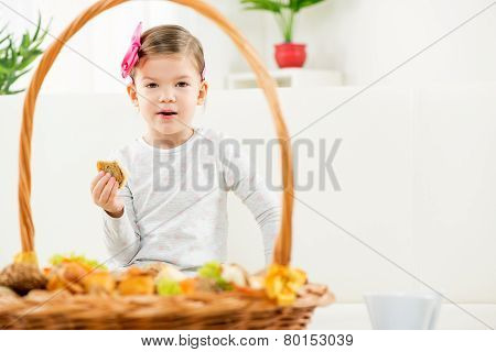 A Little Girl Eating Baked Products