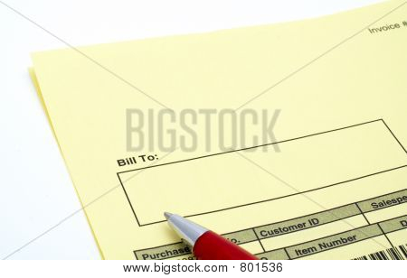 Close up Blank invoice with pen