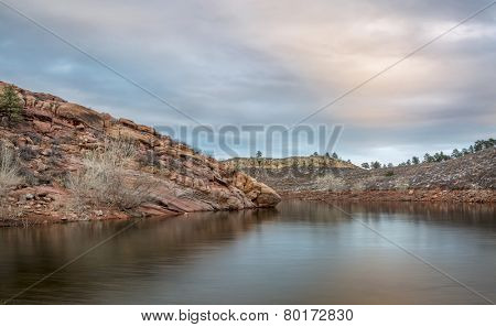 calm dusk over a lake with redstone cliffs - Horsetooth Reservoir near Fort Collins in northern Colorado