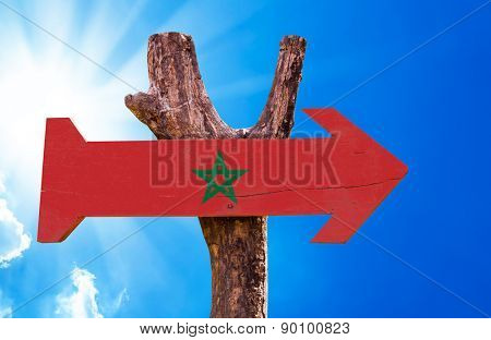 Marocco Flag wooden sign with sky background