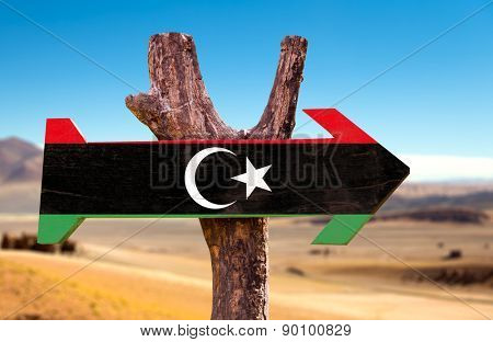 Libya Flag wooden sign with dry background