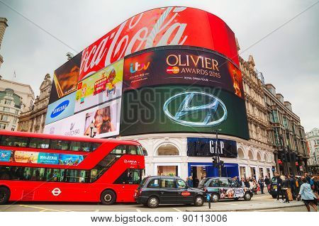 Piccadilly Circus Junction Crowded By People In London