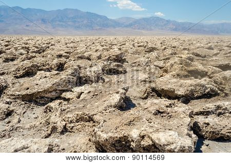 The Empty Salt Pan Of Devil's Golf Course In Death Valley, California