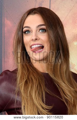 Nicholas Hoult & Riley Keough Hit Up the 'Mad Max: Fury Road' Premiere With  Zoe Kravitz