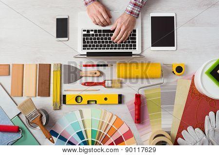 Professional Decorator Working At Desk