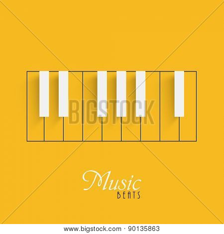 Creative piano keyboard on yellow background for Music concept.