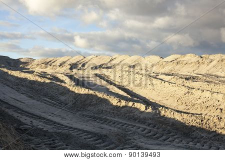 Piles Of Sand With Caterpillar Traces