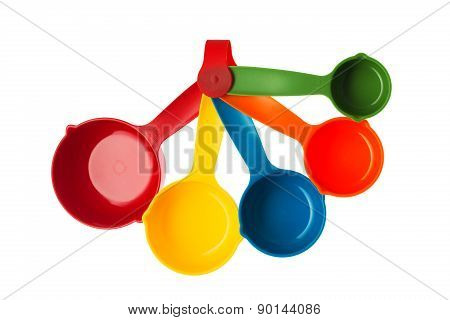 Color plastic dosing spoons isolated on a white background poster