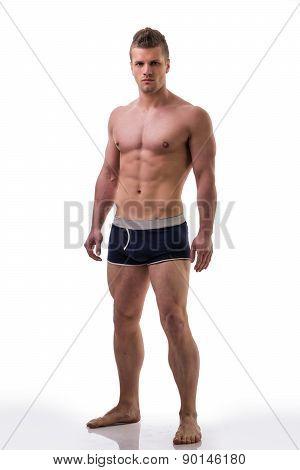 Full body shot of shirtless muscular young man