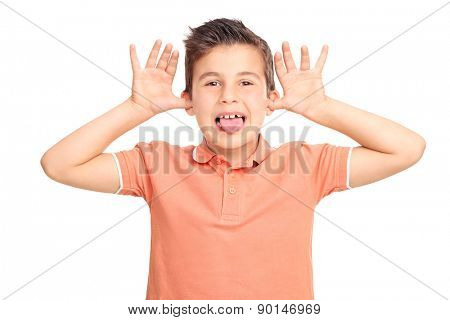 Little male kid making a face and sticking his tongue out isolated on white background