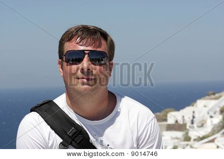 Man Poses On The Sea Background
