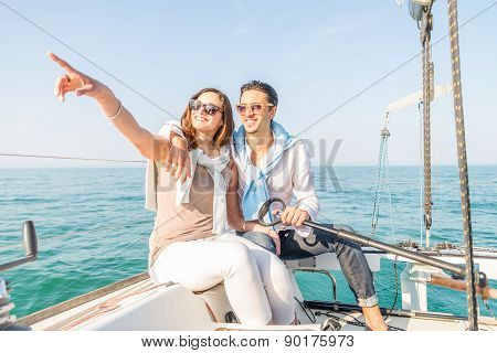 Couple Sailing On Boat