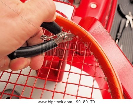 Cutting the excess string from a Tennis racquet