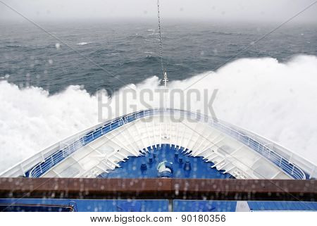 Cruise Ship bow hitting arctic waters near Spitsbergen, Svalbard, Norway.