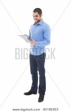 Young Handsome Arabic Man Writing Something On Clipboard Isolated On White