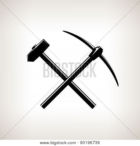 Silhouette of a Crossed Pickaxe and Sledgehammer