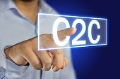 Business concept image of a businessman clicking C2C button on virtual screen over blue background poster