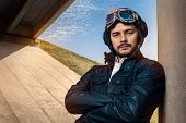 Image of a handsome and confident aviator man poster