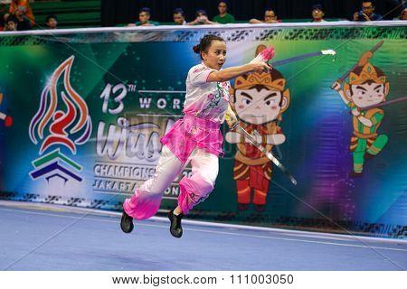 JAKARTA, INDONESIA - NOVEMBER 15, 2015: Tianhui Zheng of Hong Kong performs the movements in the women's Shuangjian event at the 13th World Wushu Championship 2015 held in Istora Senayan, Jakarta.