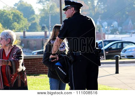 Police Officer Visually Scans the Area