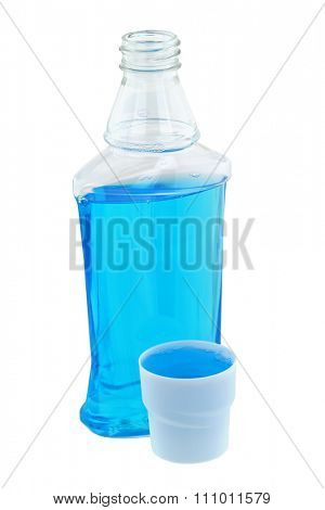 A cap full of light blue post brush antiseptic mouthwash liquid next to its bottle, isolated on white