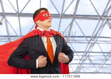 Businessman superhero in a red cloak. Business concept.