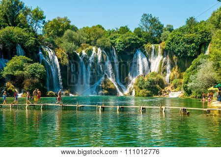 Ljubuski, Bosnia And Herzegovina - August 10, 2014: Many Tourists Visit Kravice Waterfalls On Trebiz