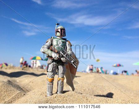 AVON, NEW JERSEY: AUGUST 15, 2013: Star Wars figure of Boba Fett on a beach.