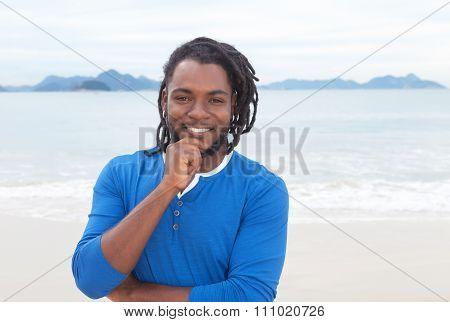 Attractive African American Guy With Dreadlocks At Beach