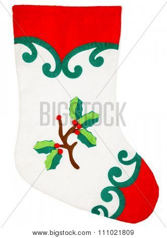 Red and white plush Christmas stocking with holly ornament on white background